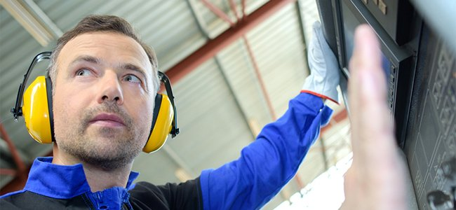 worker with ear defenders