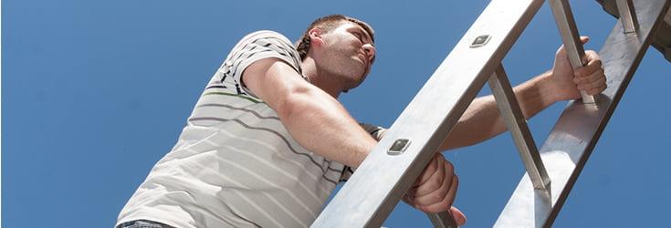 workman climbing ladder
