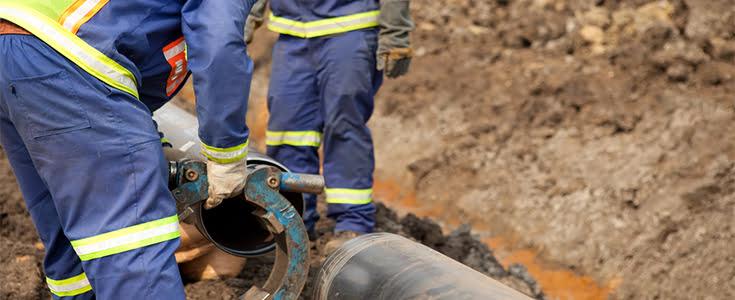 workers repairing water pipe