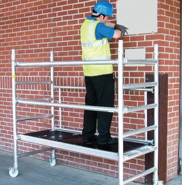 man on scaffold tower